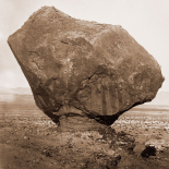 Perched Rock, Rocker Creek, Arizona, with sitting man, 1872