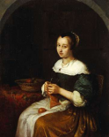 A Woman Knitting With a Basket of Fruit