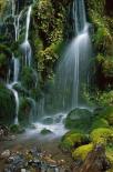 Waterfall cascading over mossy rocks, Tongariro NP, New Zealand